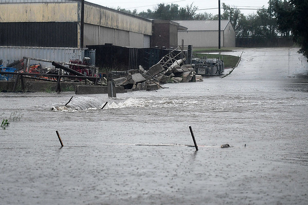 Flood waters at the intersection of 3rd and Forrest Monday May 20, 2019. (Billy Hefton / Enid News & Eagle)