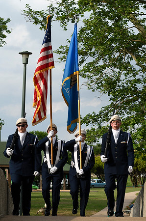Enid High School ROTC color guard presents the colors for the 104th May Fete tradition Tuesday May 7, 2019 at Government Springs Park. (Billy Hefton / Enid News & Eagle)