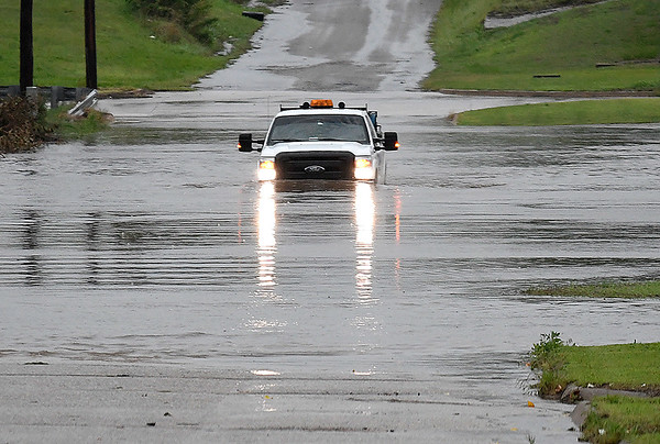 A pick-up drives through fllod water on east Oak Monday May 20, 2019. (Billy Hefton / Enid News & Eagle)