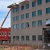 Construction workers continue work on the hotel in downtown Enid Tuesday, May 5, 2020. (Billy Hefton / Enid News & Eagle)