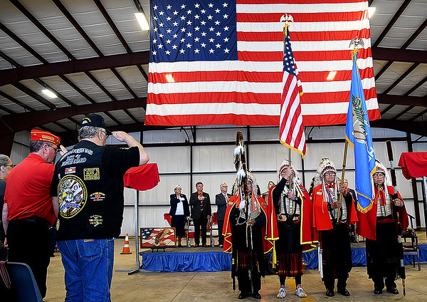 Veterans salute during the presentation of colors by the Kiowa Black Leggins Honor Society during the Woodring Wall of Honor Memorial Day ceremony Monday, May 31, 2021. (Billy Hefton / Enid News & Eagle)