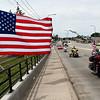 Veterans ride their motorcycle across the newly dedicated Veterans Memorial Bridge Friday, May 28, 2021. (Billy Hefton / Enid News & Eagle)