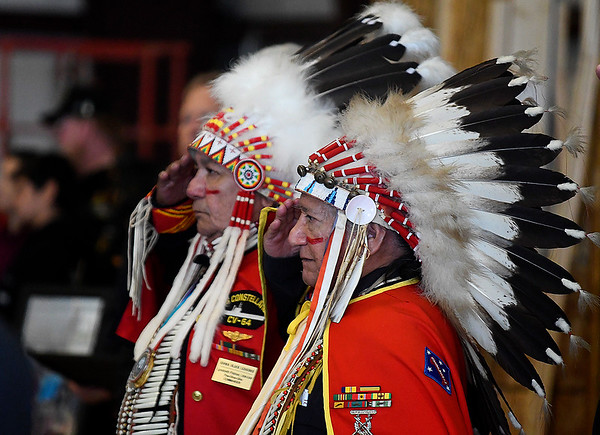 Members of the Kiowa Black Leggins Honor Society salute familes being honored during the Woodring Wall of Honor Memorial Day ceremony Monday, May 31, 2021. (Billy Hefton / Enid News & Eagle)