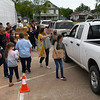 Volunteers from the Open Door Church and Calvary Baptist Church hand out boxes of food and milk at the Calvary Baptist Church parking lot Wednesday, May 5, 2021. (Billy Hefton / Enid News & Eagle)