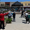 Worshipers pray during the National Day of Prayer event at the Garfield County Courthouse gazebo Thursday, May 6, 2021. (Billy Hefton / Enid News & Eagle)