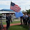 Members of the Enid High School Junior ROTC Color Guard present the colors during the Veterans Memorial Bridge Dedication Friday, May 28, 2021 at AMBUCS Park. (Billy Hefton / Enid News & Eagle)