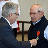 Grant Moak (left), Honorary French Consul, presents R.D. Lawrence with the Order of the French Legion of Honor during the Woodring Wall of Honor Memorial Day ceremony Monday, May 31, 2021. (Billy Hefton / Enid News & Eagle)