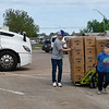 (left to right) Bip Altamirano, Eli Hisey and Isaac Jones move a pallet of food and milk at the Calvary Baptist Church parking lot Wednesday, May 5, 2021. The food and milk was given away by the Open Door Church and Calvary Baptist Church. (Billy Hefton / Enid News & Eagle)