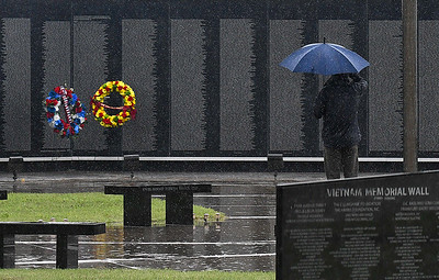 A man salutes the Vietnam Memorial Wall Memorial Day Monday, May 31, 2021. (Billy Hefton / Enid News & Eagle)