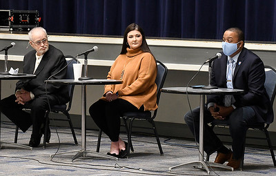 Ward 4 city commission candidates, Loyd Kaufman (left) and Whitney Roberts, listen to Jonathan Waddell (right) answer a question during a candidate forum Tuesday, January 16, 2021 at the Stride Bank Center. (Billy Hefton / Enid News & Eagle)