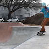 Kyle Dillingham plays the violin as he skateboards on the new Enid Skate Park following a ribbon cutting Friday, January 8, 2021. (Billy Hefton / Enid News & Eagle)