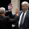 Enid mayor, George Pankonin (left), gives the oath of office to Jeff Funk during the city commission meeting Tuesday, January 5, 2021 at the Stride Bank Center. Funk was selected  to sever the remaining five months as Ward 6 commissioner. (Billy Hefton / Enid News & Eagle)