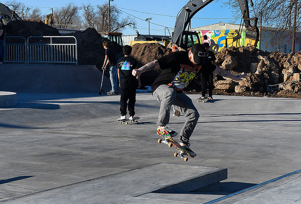 Nate Terrin executes a trick at the new skate park on the southwest corner of Randolph and 5th Monday, January 4, 2021. (Billy Hefton / Endi News & Eagle)