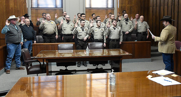 Garfield County deputies are sworn in by new Garfield County Sheriff Cory Rink Monday, January 4, 2021 at the Garfield County Courthouse. (Billy Hefton / Enid News & Eagle)
