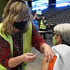 Bobbie Smith from the Garfield County Health Department gives a COVID-19 vaccine shot at the Stride Bank Center Monday, January 4, 2021. (Billy Hefton / Enid News & Eagle)