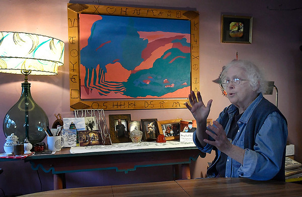 Margaret Moss gestures as she talks about one of the pieces of art she has been invited to exhibit at the Vernon Filley Art Museum in Pratt, Kansas. (Billy Hefton / Enid News & Eagle)
