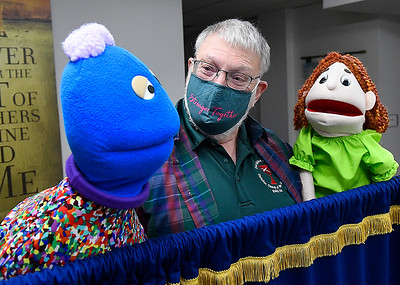Rev. Paul Ragle, new pastor at the Christian Church of the Covenant, shows off puppets, Monahan and Sara, during an interview Tuesday, January 26, 2021. (Billy Hefton / Endi News & Eagle)