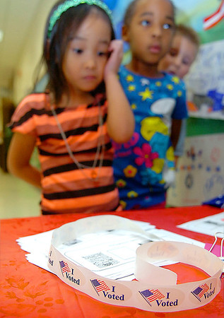Kindergarten students at Adams Elementary wait to cast their votes for either Duck or Grace Monday during the school's election. (Staff Photo by BILLY HEFTON)