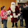 Adoring fans greet Santa at Oakwood Mall Friday. (Staff Photo by BONNIE VCULEK)