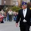 Doug Frantz, former City of Enid mayor, marches south on Independence during the Veterans Parade Sunday. Frantz was a Military Order Purple Heart recipient for his United States Marine Corps service. (Staff Photo by BONNIE VCULEK)