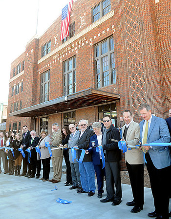 Dignitaries cut the ceremonial blue ribbon during the Enid Convention Hall grand re-opening Thursday in downtown Enid. (Staff Photo by BONNIE VCULEK)