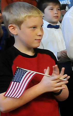 A Prairie View Elementary School student shows his patriotic spirit as he applauds during the Veterans Day Assembly Friday. (Staff Photo by BONNIE VCULEK)