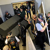 "Vietnam Veterans carry two panels of the American Veterans Traveling Tribute Wall up the stairs at Convention Hall Friday during a ""Welcome Home"" ceremony. (Staff Photo by BONNIE VCULEK)"