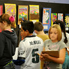 Monroe Elementary School students critique fifth grade art work Wednesday at Park Avenue Thrift. Three different classes took turns <br /> examining the artistic creations, drawing mural designs and enjoying<br /> refreshments during their hands-on art lesson. (Staff Photo by BONNIE VCULEK)