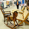 Handmade furniture, toys and quilts await auction during the Oklahoma Mennonite Relief Sale Saturday at the Chisholm Trail Expo Center Pavilion. Proceeds from the donated items and food sales support the Mennonite disaster relief projects around the world. (Staff Photo by BONNIE VCULEK)