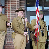 Cody Jolliff salutes during the singing of the National Anthem at Convention Hall Sunday. Jolliff, Matt Reed, Christian Rountree, Nathan Buckendorf (from left) and Mike Buckendorf (not pictured) re-enacted World War I scenes during the annual Veterans Day parade and the Convention Hall ceremony. (Staff Photo by BONNIE VCULEK)