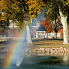 Sunlight and wind blown spray combine to produce a rainbow at the fountain at Government Springs Park Tuesday. (Staff Photo by BILLY HEFTON)S