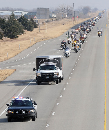 Oklahoma Highway Patrol (front left) escorts the American Veterans Traveling Tribute Wall to Enid Friday as 300 Vietnam Veterans, retired and active military and family members of veterans form a 2-3 mile long motorcycle procession along U.S. 412. (Staff Photo by BONNIE VCULEK)
