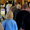 Enid residents wait patiently in line for their ballots Tuesday at Precinct 201 - Central Christian Church, 1111 W. Broadway. Garfield County Election workers indicated that voting had been steady throughout the day at all precincts with several voters waiting up to an hour between 1-4 p.m. (Staff Photo by BONNIE VCULEK)