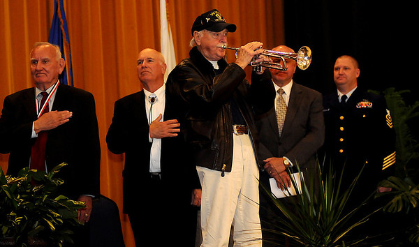 "Doc Bryant (front, center) plays ""Taps"" during the Woodring Wall of Honor Legacy Veterans Award Ceremony Sunday. Norman Lamb (far left) received the Legacy Lifetime Achievement Award during the event in the Convention Hall Grand Ballroom. (Staff Photo by BONNIE VCULEK)"
