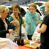 Shannon Campbell (right), from Styria Bakery, answers her customers questions about breads Saturday during Home for the Holidays at the Chisholm Trail Expo Center. (Staff Photo by BONNIE VCULEK)