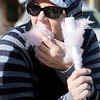 Cindy Rogers munches on cotton candy for the first time since her childhood Saturday during Forgotten Ministry's fun on the square. (Staff Photo by BONNIE VCULEK)
