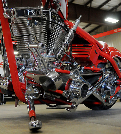 """Snap-on's """"Tool Chopper,"""" designed and built by Orange County Choppers, features a miniature tool box under the seat, wrenches, rachetts, sockets, extensions, and hexagon shaped tubing in the frame of the unique bike during the Snap-on Masters of Metal Tool Trade Show Thursday at the Chisholm Trail Expo Center Pavilion. Displays included the specially designed chopper, the Snap-on Dragster and interactive activities for area customers. (Staff Photo by BONNIE VCULEK)"""