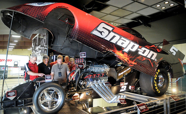 Nathan Brown and Bob Davisson, Snap-on dealers from Enid, discuss the features of the Snap-on funny car Thursday during the Snap-on Masters of Metal Tour at the Chisholm Trail Expo Center Pavilion. (Staff Photo by BONNIE VCULEK)
