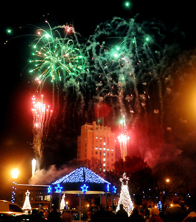 Fireworks illuminate the Friday evening sky during Enid Lights Up the Plains. (Staff Photo by BONNIE VCULEK)