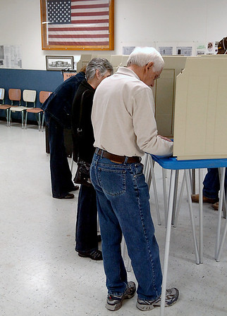 Voters fill the booths at Kremlin FWZ Community Center Tuesday casting their ballots in the general election. (Staff Photo by BILLY HEFTON)