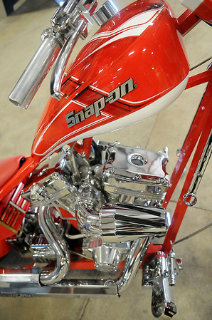 """Snap-on's """"Tool Chopper,"""" designed and built by Orange County Choppers, features a miniature tool box under the seat, wrenches, rachetts, sockets, extensions, and hexagon shaped tubing in the frame of the unique bike. The Snap-on Masters of Metal Tool Trade Show displays included the Snap-on Funny Car, the specially designed chopper, and interactive activities for area customers. (Staff Photo by BONNIE VCULEK)"""