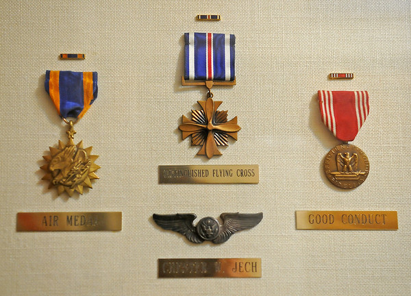 Chester Jech proudly displays the Army Air Corps Air, Distinguished Flying Cross and Good Conduct medals that he was awarded during World War II. Jech resides at Country Woods Assisted Living in Kingfisher. (Staff Photo by BONNIE VCULEK)