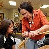 Lynn Carmichael shows fourth grader, Jared Vega, how to weave wheat Tuesday at Prairie View Elementary. (Staff Photo by BILLY HEFTON)