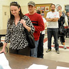 A woman (seated, top left) votes as other Enid residents wait patiently in line for their ballots Tuesday at Precinct 201 - Central Christian Church, 1111 W. Broadway. Garfield County Election workers indicated that voting had been steady throughout the day at all precincts with several voters waiting up to an hour between 1-4 p.m. (Staff Photo by BONNIE VCULEK)