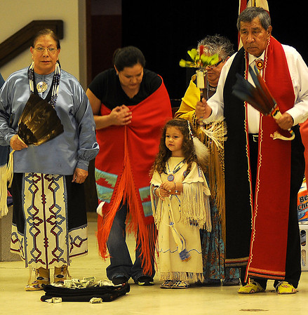 Little Andee Grace Rader (center) helps honor Linda Big Soldier (left), the Head Lady Dancer for the Enid Inter-Tribal Club Gourd Dance Saturday at the Hoover Building on the Garfield County Fairgrounds. (Staff Photo by BONNIE VCULEK)