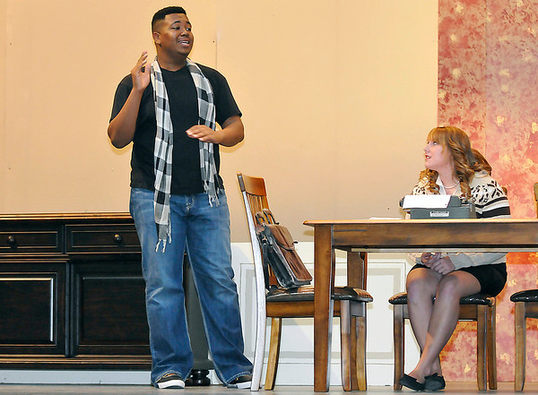"""Nick Holden and Kimmy Carris rehearse the EHS production of """"The Dining Room"""" Monday at the Enid High School auditorium. Performances will be Thursday and Friday at 7:30 p.m.. (Staff Photo by BILLY HEFTON)"""
