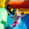 Autumn Rogers sails through the air as she joins other children on an inflatable slide Saturday during Forgotten Ministry's fun on the Garfield County Court House Lawn. (Staff Photo by BONNIE VCULEK)