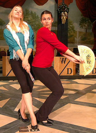 Lindsey Newell and Louisa Dienst rehearse for the production of White Christmas. (Staff Photo by BILLY HEFTON)