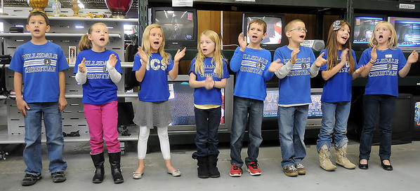 "Kellen Epps, Brooklyn Phillips, Taryn Gray, Adi Betz, Landon Schultz, Daniel Voth, Emily Corey and Alice Watkins (from left), second grade students from Hillsdale Christian School, perform ""Count Your Blessings"" at Hope Outreach Tuesday. (Staff Photo by BONNIE VCULEK)"
