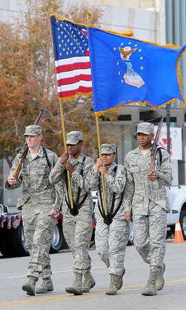 Vance Air Force Base Silver Talon Honor Guard march during the Veterans Day Parade Sunday. (Staff Photo by BONNIE VCULEK)